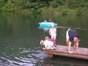People on the dock of Gary's Putter Golf & Jiffy Pup