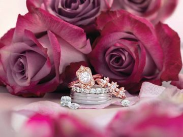 Bethany's Jewelry and Design rings in front of a flower